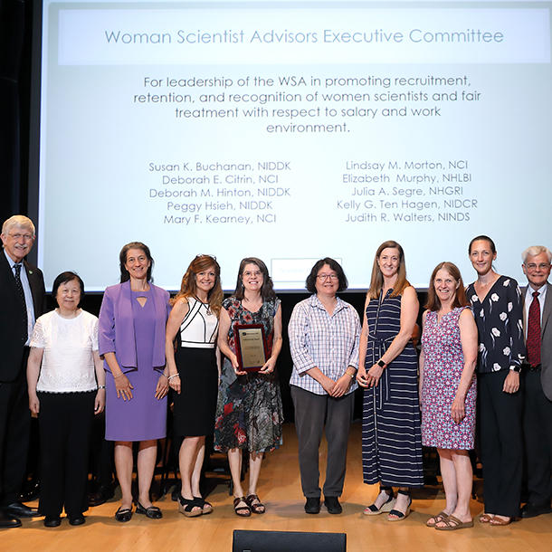 Lindsay Morton and others on the Women Scientist Advisors Executive Committee receive NIH Director's Award from Francis Collins.
