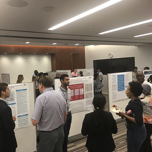 Summer interns discuss their research with DCEG colleagues and peers.