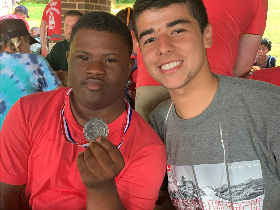 Frank Colon-Matos with camper and his medal at Camp Fantastic 2019