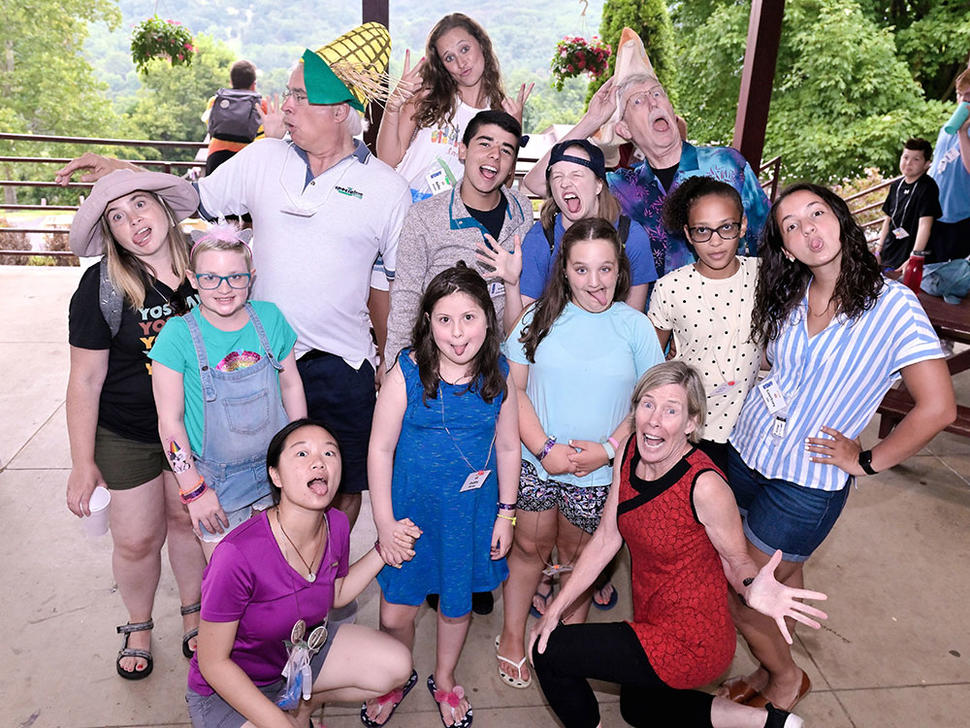Stephen Chanock, Francis Collins, DCEG counselors, and campers pose for silly photo.