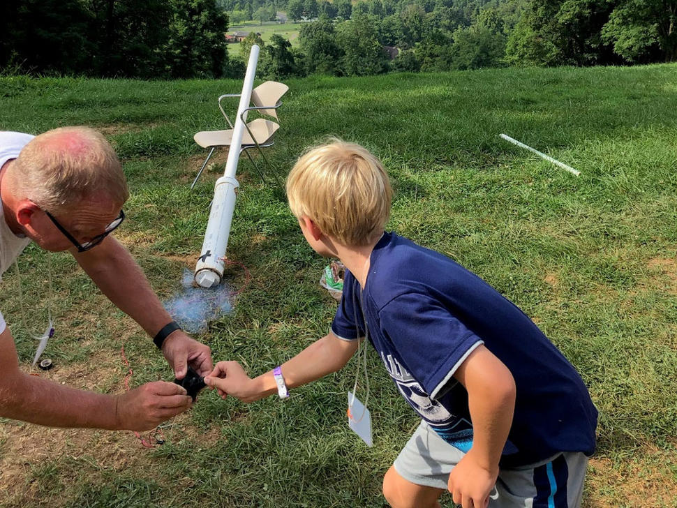 Camper and counselor launch potato rockets at Camp Fantastic