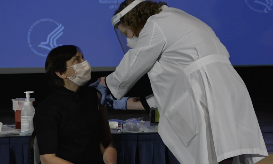 Neelam Giri receives a covid vaccine at the NIH clinical center.